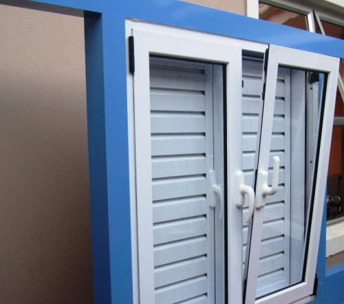 Aluminium Turn n tilt double glazed window with shutters